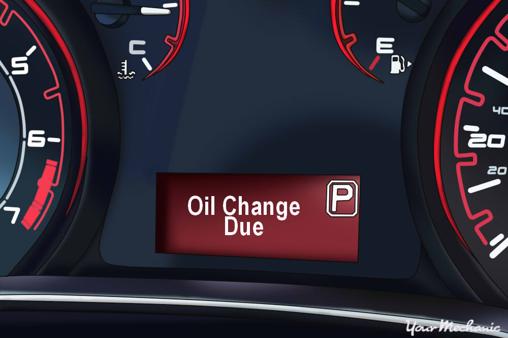 1 - Understanding Dodge's Oil Change Indicator System - Dodge instrument display with oil change light on