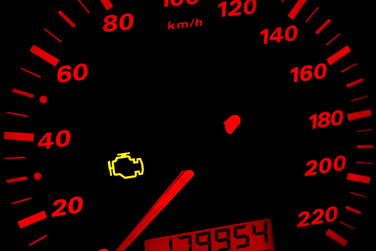 37035768-check-engine-light-car-dashboard-in-closeup